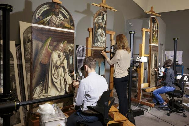 Restorers from the Royal Institute for Cultural Heritage at work on the Ghent Altarpiece ( c . 1425–32) by Hubert and Jan van Eyck in the Museum of Fine Arts Ghent.