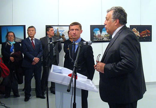 Andrei Karlov (R), the Russian ambassador to Ankara, gives a speech before being shot by a gunman (unseen) during an art exhibition in Ankara. Photo: UGUR KAVAS/AFP/Getty Images
