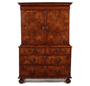 A William & Mary kingwood oyster veneered cabinet on chest attributed to Thomas Pistor £20,000-30,000. The Pedestal