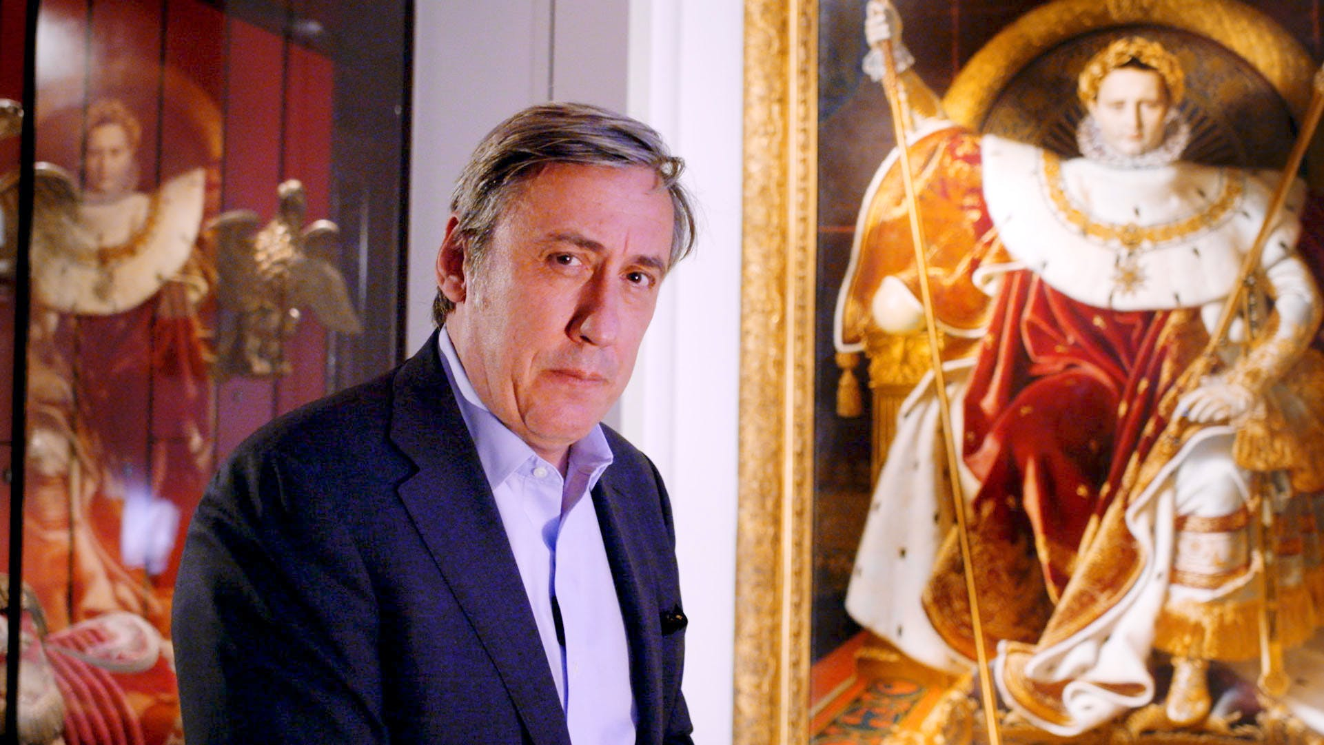Andrew Graham-Dixon in front of 'Napoleon 1 on his Imperial Throne', by Ingres at the Musée de l'Armée, Paris. From the BBC's 'The Art of France'. © BBC