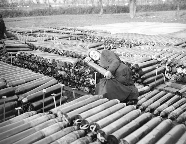 An Italian Female Worker Employed by the British Army, Lying on 18 Pounder Shells (1918), William Joseph Brunell. Courtesy: Imperial War Museum