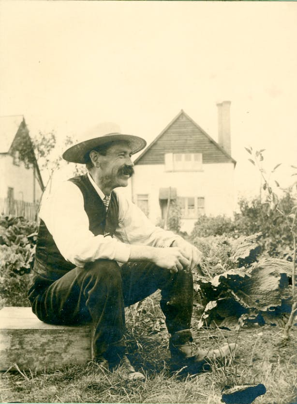 George Bates, probably sitting outside his allotment, (c. 1905).