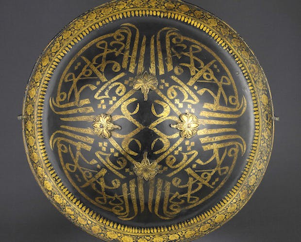 Lacquered hide shield (dhal), second half of the 18th century, India, probably Mysore, buffalo hide, gold and velvet, diam. 45cm. Peter Finer (£200,000)