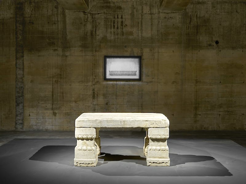 A 2010 daguerreotype by Adam Fuss hangs above a Chinese imperial stone table from the early Qing dynasty (17th century), installation view, Feuerle Collection, Berlin. Photo: def image; © The Feuerle Collection