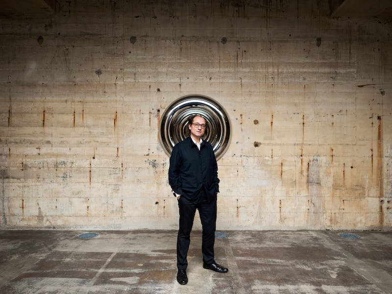 Désiré Feuerle photographed at his museum in Berlin beside Anish Kapoor's Torus (2002). Photo: def image; © The Feuerle Collection