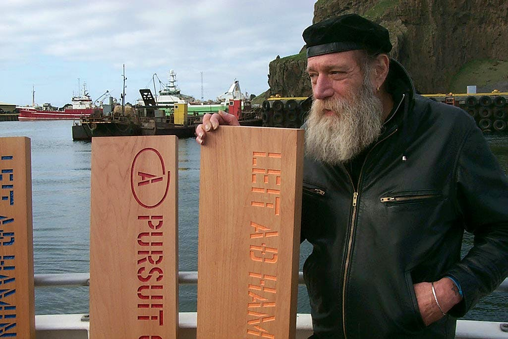 Lawrence Weiner about to leave port in Reykjavik to jettison his planks A PURSUIT OF HAPPINESS ASAP as his participation in Reykjavik Arts Festival, Iceland, 2005. © Lawrence Weiner