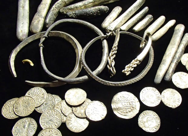 Selection of items from the Watlington Hoard showing the range of objects discovered: arm-rings, ingots, coins and cut-up pieces of silver and gold. © Trustees of the British Museum