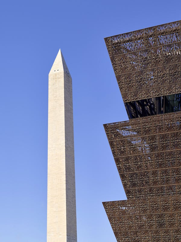 The Washington Monument and the facade of the National Museum of African American History and Culture, Washington, D.C. Photo: Alan Karchmer/NMAAHC