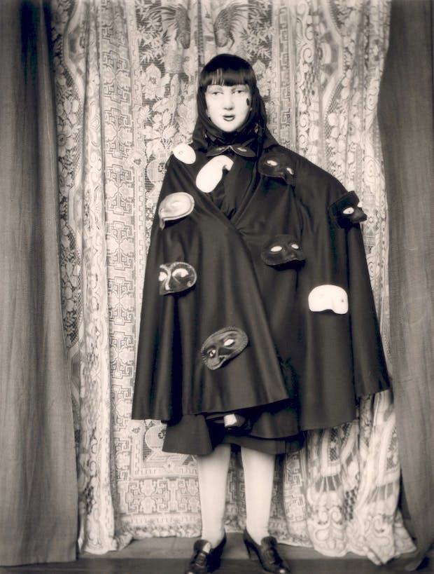 Self Portrait (full length figure in cloak and masks) (1928), Claude Cahun. © Jersey Heritage