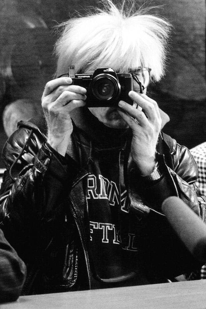 Andy Warhol at the opening of Andy Warhol – Il Cenacolo at Palazzo delle Stelline, Milan, January 22, 1987. © Maria Mulas. Courtesy Gagosian