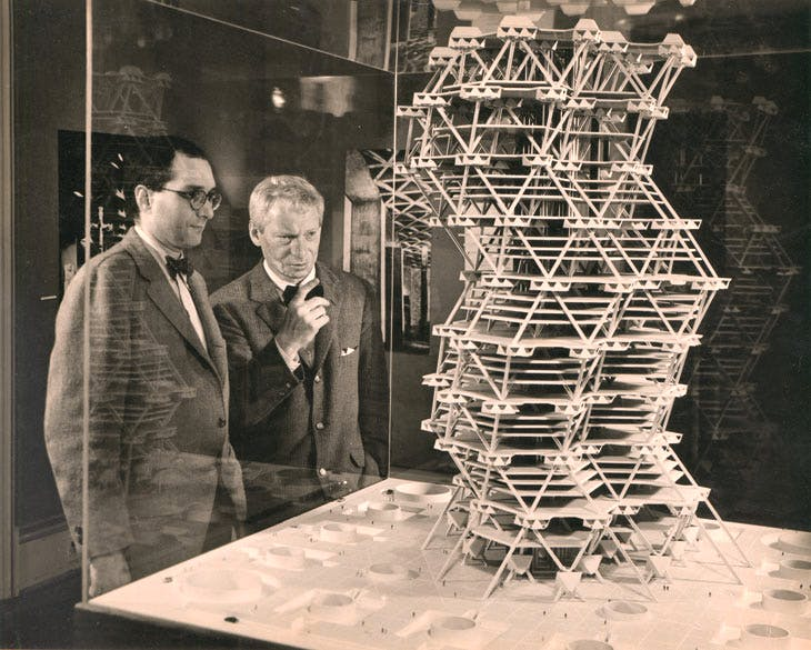 Louis Kahn in front of a model of the City Tower Project in an exhibition at Cornell University, Ithaca, New York, February 1958. © Sue Ann Kahn