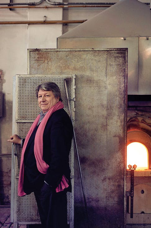 Adriano Berengo standing in front of a glass furnace at the Berengo Studio, Murano, Venice, 2011. Photo: Hugo Thomassen; courtesy Fondazione Berengo