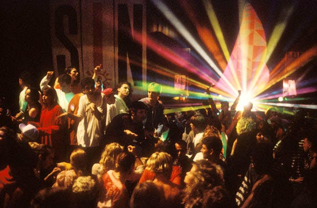 Ravers on the dancefloor at The Trip at Astoria, London (1988), David Swindells. Image courtesy Youth Club Archive