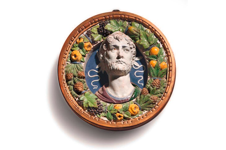 A polychrome glazed terracotta bust of a laureate in a frame of fruit, vegetables and pine cones (c. 1487–94), Andrea della Robbia