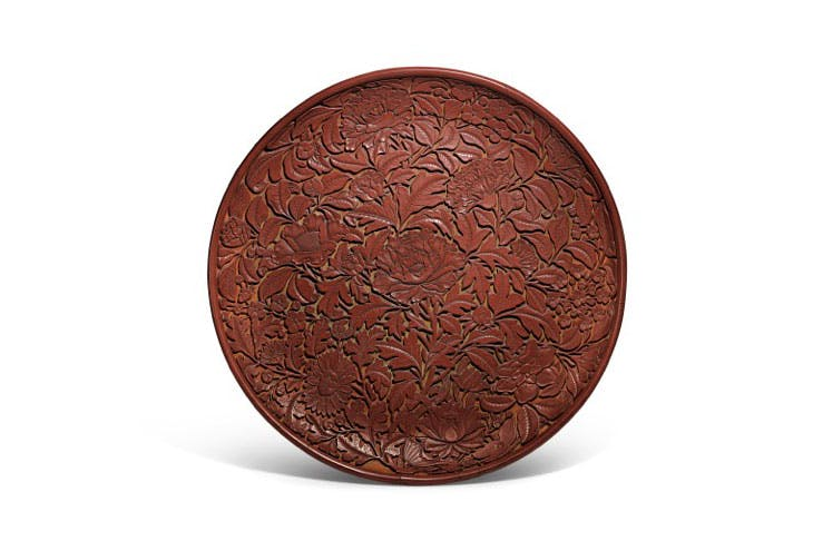 Carved cinnabar lacquer dish (Lat Yuan/early Ming dynasty), China. Sotheby's.