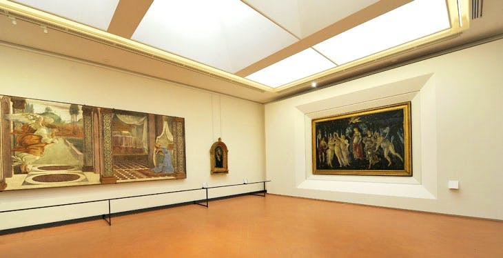 View of The Annuniciation of San Martino alla Scala (1481), and the Primavera (c. 1482), in the rehung Botticelli rooms at the Uffizi