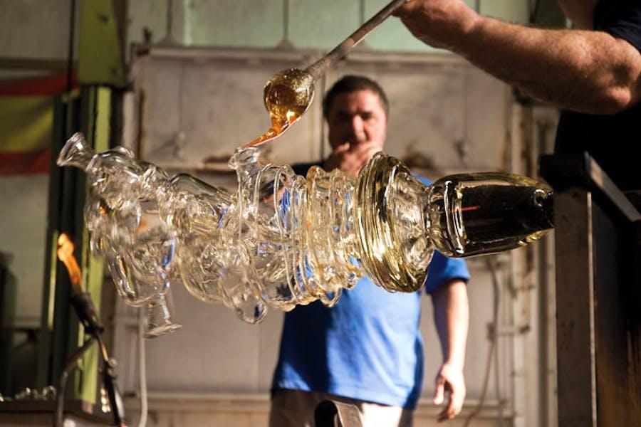 Berengo Studio glassmasters working on a Tony Cragg sculpture, 'Glasstress 2009'. Courtesy Fondazione Berengo