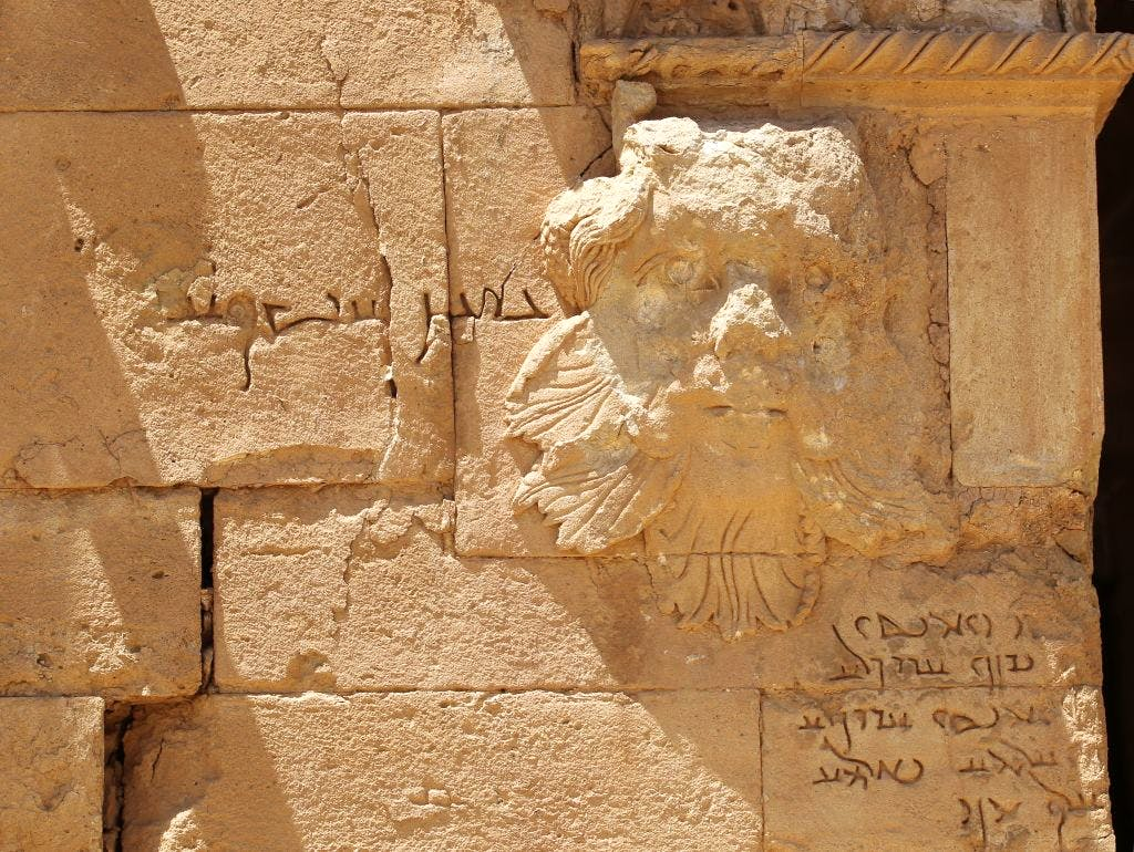 An Aramaic inscription next to this relief identifies it as a Gorgon. A video released by ISIS in 2015 features a militant attacking the piece with a sledgehammer. Damage can be seen to the top of the head and nose. Photo: AHMAD AL-RUBAYE/AFP/Getty Images.