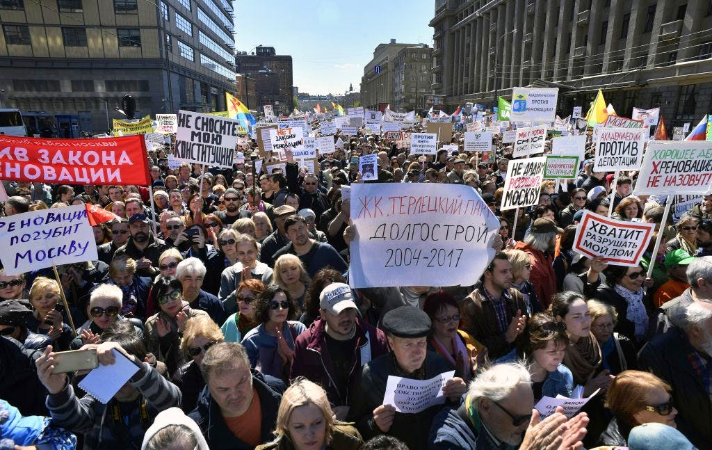 Demonstrators march during a protest in Moscow on 14 May, 2017, against the city's controversial plan to knock down Soviet-era apartment blocks and redevelop the old neighbourhoods. ALEXANDER NEMENOV/AFP/Getty Images