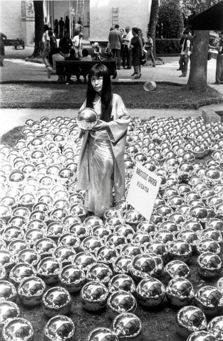 Photograph of Yayoi Kusama and her installation, Narcissus Garden in Venice, 1966. Collection of the Artist © Yayoi Kusama