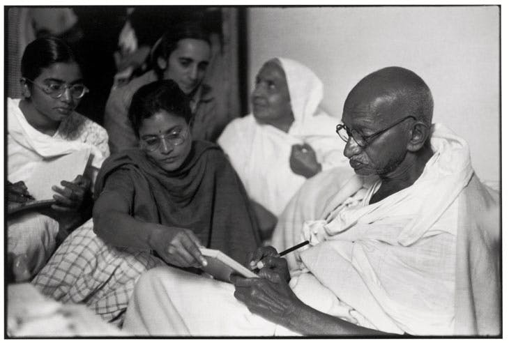 Gandhi dictates a message, just after breaking his fast Birla House, Delhi, India (1948), Henri Cartier-Bresson. © Henri Cartier-Bresson/Magnum Photos