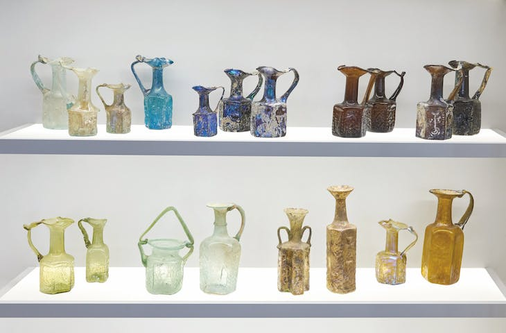 Glass and vessels on display in the Jay and Jeanie Schottenstein National Campus for the Archaeology of Israel, in a gallery focusing on the glass industry in Israel and the ancient world