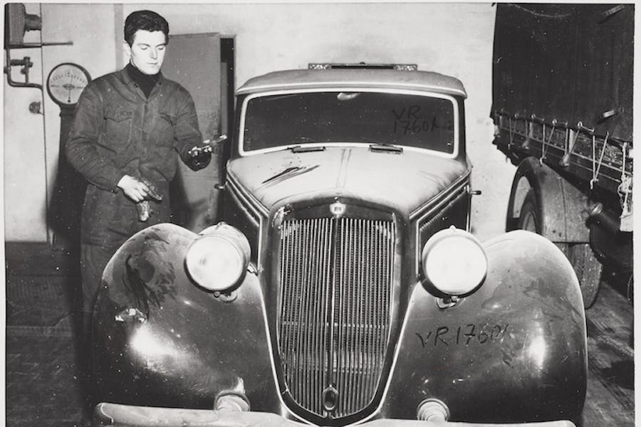 Benito Mussolini's dust covered motor car languishes in a Milan garage ten years after his death (1955), photographer unknown. Image courtesy of Whitechapel Gallery