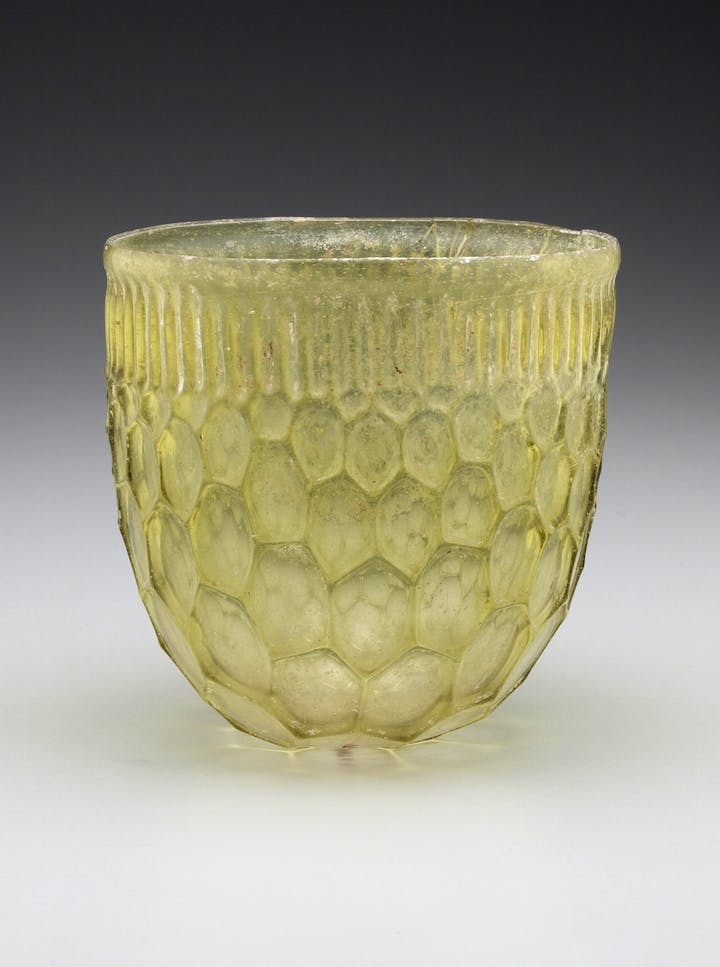 Roman honeycomb beaker, Eastern Mediterranean or Western Empire, 4th century A.D., cast and free-blown glass.