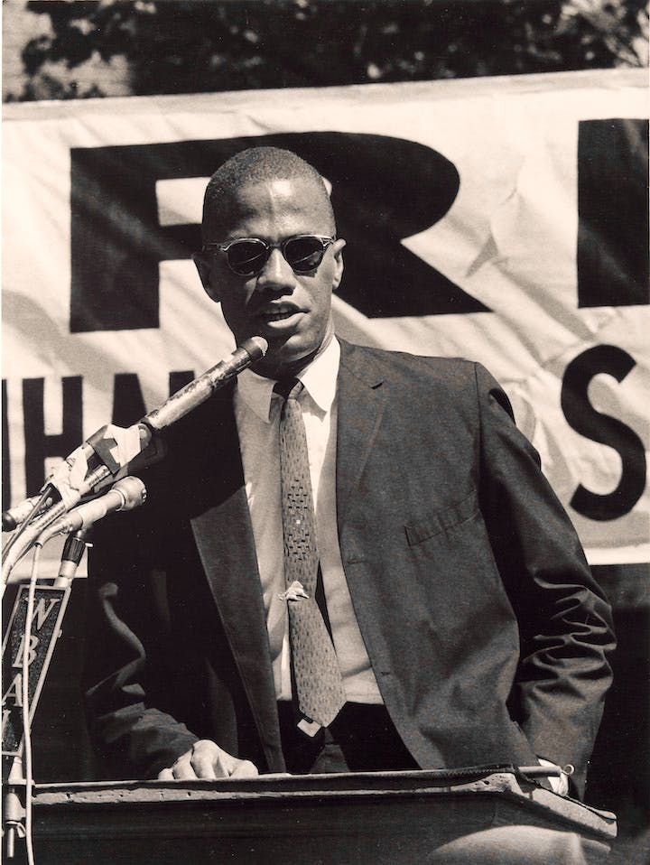 Malcolm X Speaks at a Rally in Harlem (at 115th St. & Lenox Ave.), New York, September 7, 1963 (1963), Adger Cowans. Courtesy of Detroit Institute of Arts