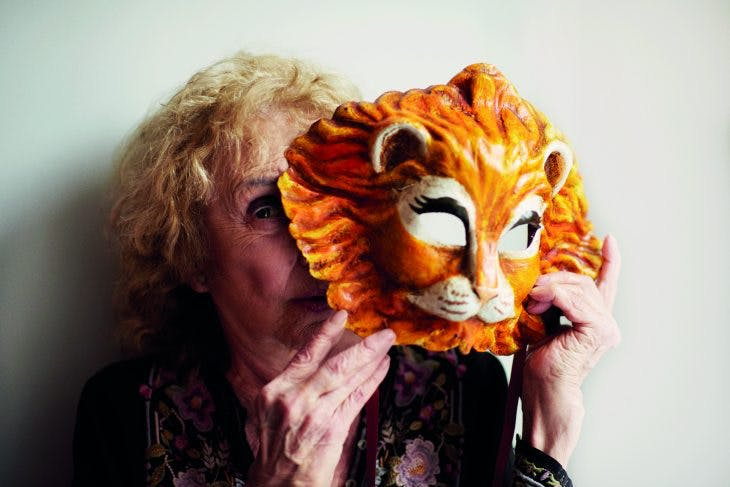 Carolee Schneemann holding a Venetian lion mask, photographed in London in May 2017, Photo: Benjamin McMahon