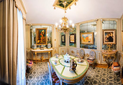 Paintings by De Chirico hang in the mirrored dining room of Francesco Federico Cerruti's villa. Photo: Gabriele Gaidano