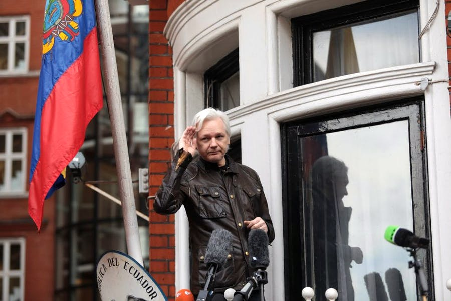 Julian Assange gestures as he speaks to the media from the balcony of the Embassy Of Ecuador on May 19, 2017 in London, England. Photo by Jack Taylor/Getty Images