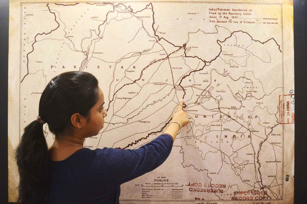 A visitor looks at a map of the India-Pakistan boundaries as fixed by the boundary commission on 17 August, 1947 at the Partition Museum in Amritsar. NARINDER NANU/AFP/Getty Images