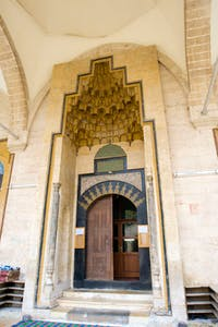 The doorway to the prayer hall of the Khosrofiye Mosque, the work of Sinan (1546), the great court architect to Suleiman the Magnificent. The structure was obliterated by a tunnel bomb in 2014.