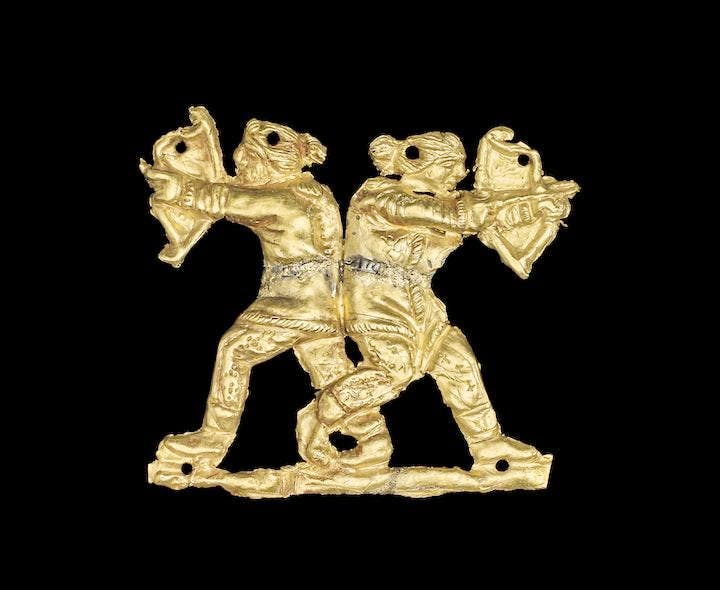 Gold applique showing two archers back to back, Kul Oba, 400–350 BC. © The Trustees of the British Museum