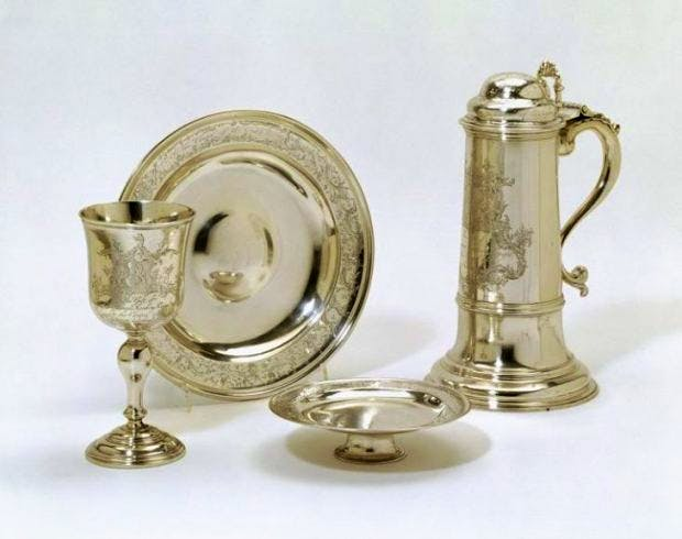 The silver cup, paten, flagon, alms dish for use in Holy Communion celebrated in the Chapel of the Asylum of the Female Orphans, Vauxhall, maker's mark of Abraham Portal, London (1763-4), Victoria and Albert Museum