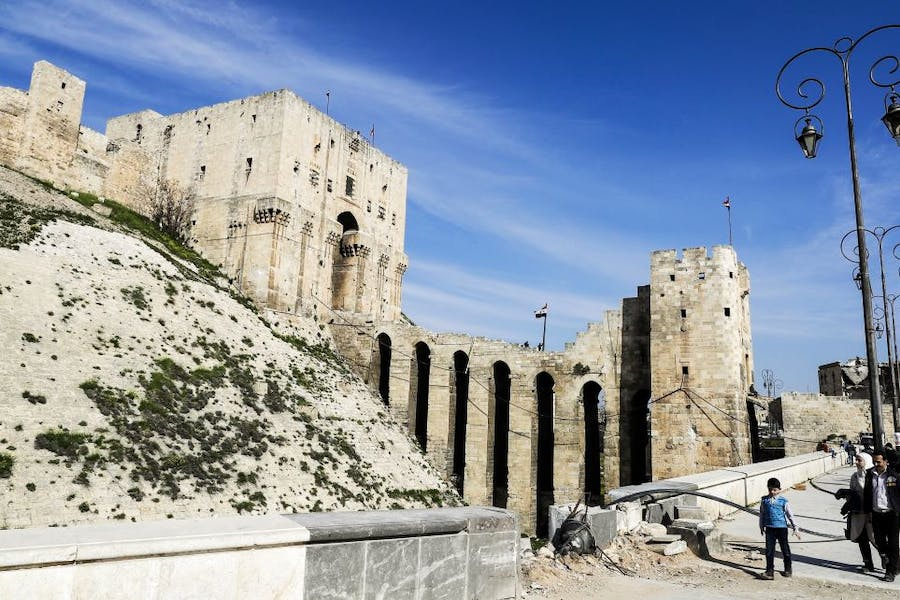 The double entrance gateway to the Aleppo Citadel, largely the work of the late 12th century Ayyubid rulers of Aleppo (pictured here on 9 March, 2017) has largely survived the conflict with only minor damage. Photo: JOSEPH EID/AFP/Getty Images
