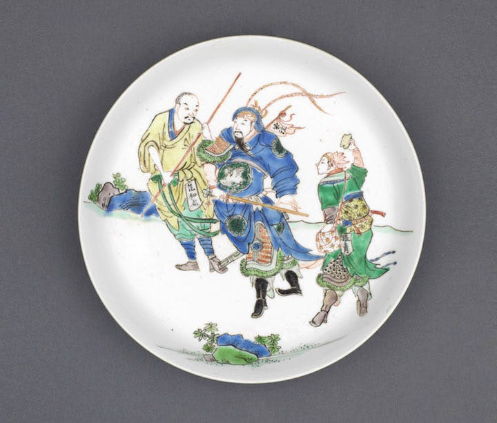 Saucer depicting three figures from the stories of the Water Margin, c. 1690, China, Kangxi period, diam. 17.5cm. Marchant (£78,000)