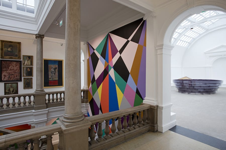 West Gallery with view into Central Court and Alison Wilding's 'Arena', 2000. Leeds Art Gallery.