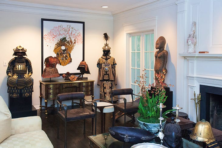 In the living room, a complete set of early Edo period dangaedo tosei gusoku armour from the 17th century (left) and a 19th-century Manchu officer's uniform flank Chinese lacquered leather Nuosu armour from the Yi culture, China, late 18th-early 19th century.