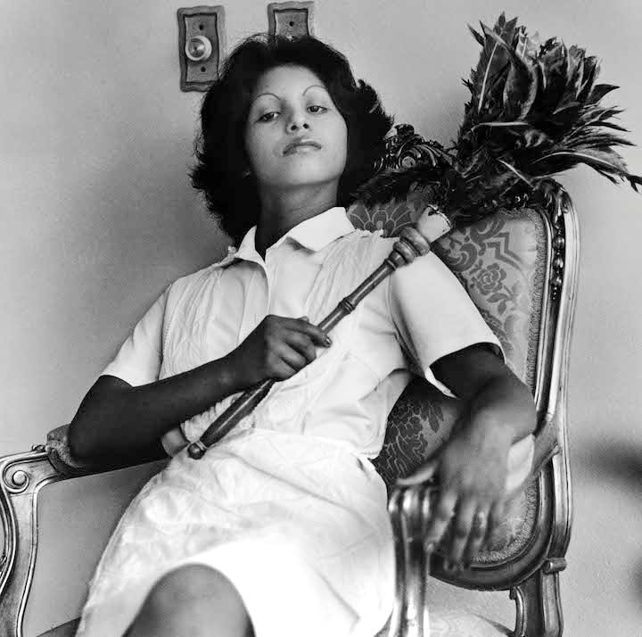 Edita [the one with the feather duster], Panama (from the series Servitude; 1977), Sandra Eleta. Courtesy of Galería Arteconsult S.A., Panama. © the artist