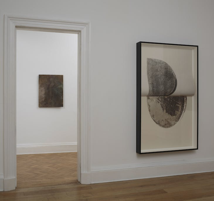 Installation view of 'Slow Objects' at the Common Guild, Glasgow, showing Vanessa Billy's Old Cloud (2017) and Erin Shirreff's Relief (no 3) (2015).