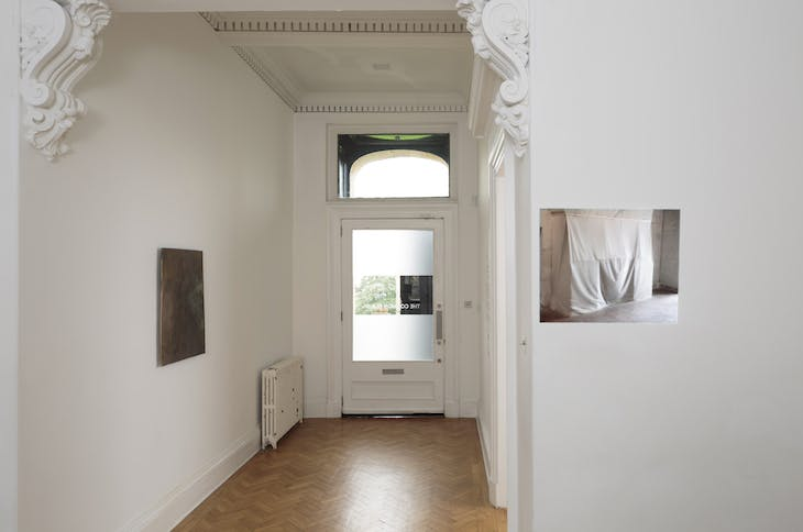 Installation view of 'Slow Objects' at the Common Guild, Glasgow, showing Vanessa Billy's Old Cloud (2017) and Edith Dekyndt's Slow Object 01 (1997)
