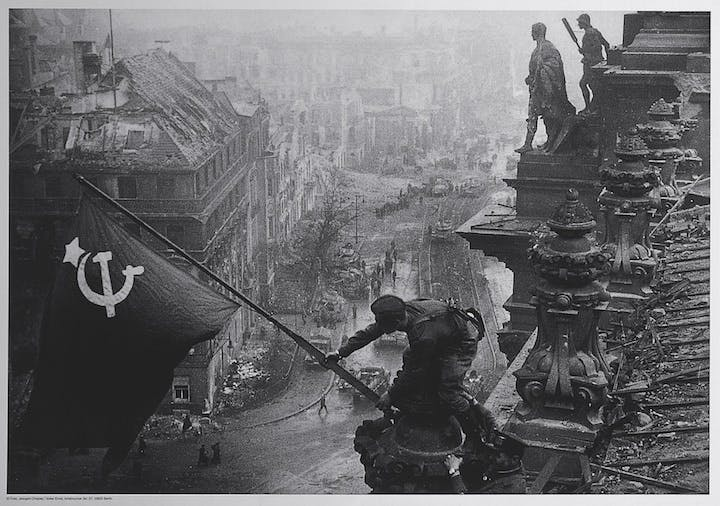 Soviet soldiers raising the red flag over the Reichstag, May 1945, Yevgeny Khaldei. The David King Collection at Tate