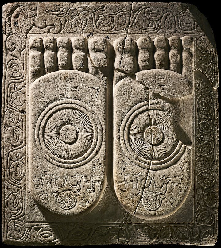 Footprints of the Buddha (c. 100–300), found at Amavarati, India. © Trustees of the British Museum
