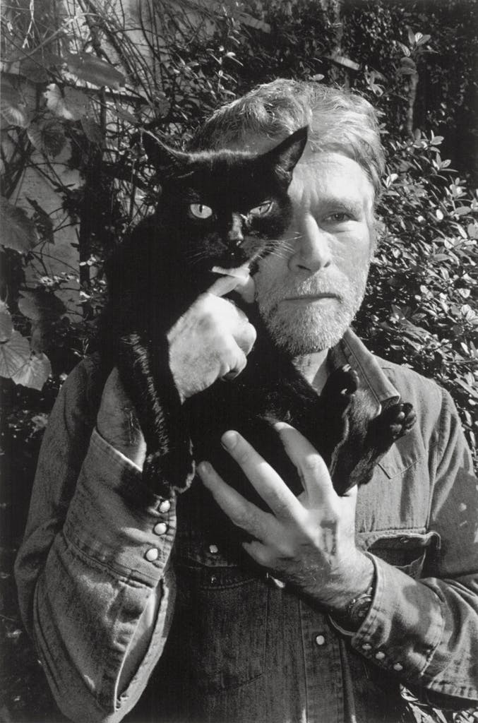 R.B. Kitaj photographed in London with his cat by Lee Friedlander.