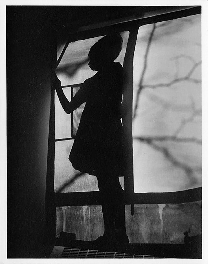 Shadow across a window in a Stuyvesant Town apartment complex, photographed in c. 1954 by Vivian Maier, Ron Slattery collection, © 2017 The Estate of Vivian Maier