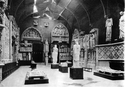 The Erechtheion caryatid, purchased from the British Museum and displayed in the 12th-century gallery of the Trocadéro, adjacent to the smiling angel from Reims Cathedral. From P. F. J. Marcou, Album du Musée de Sculpture Comparée, vol. 2 (Paris, 1897), courtesy Princeton University Press