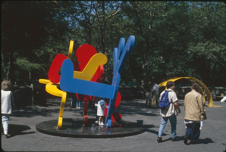 Keith Haring's Yellow Arching Figure and Untitled (Three Dancing Figures), installed at Doris C. Freedman Plaza, New York in 1997.