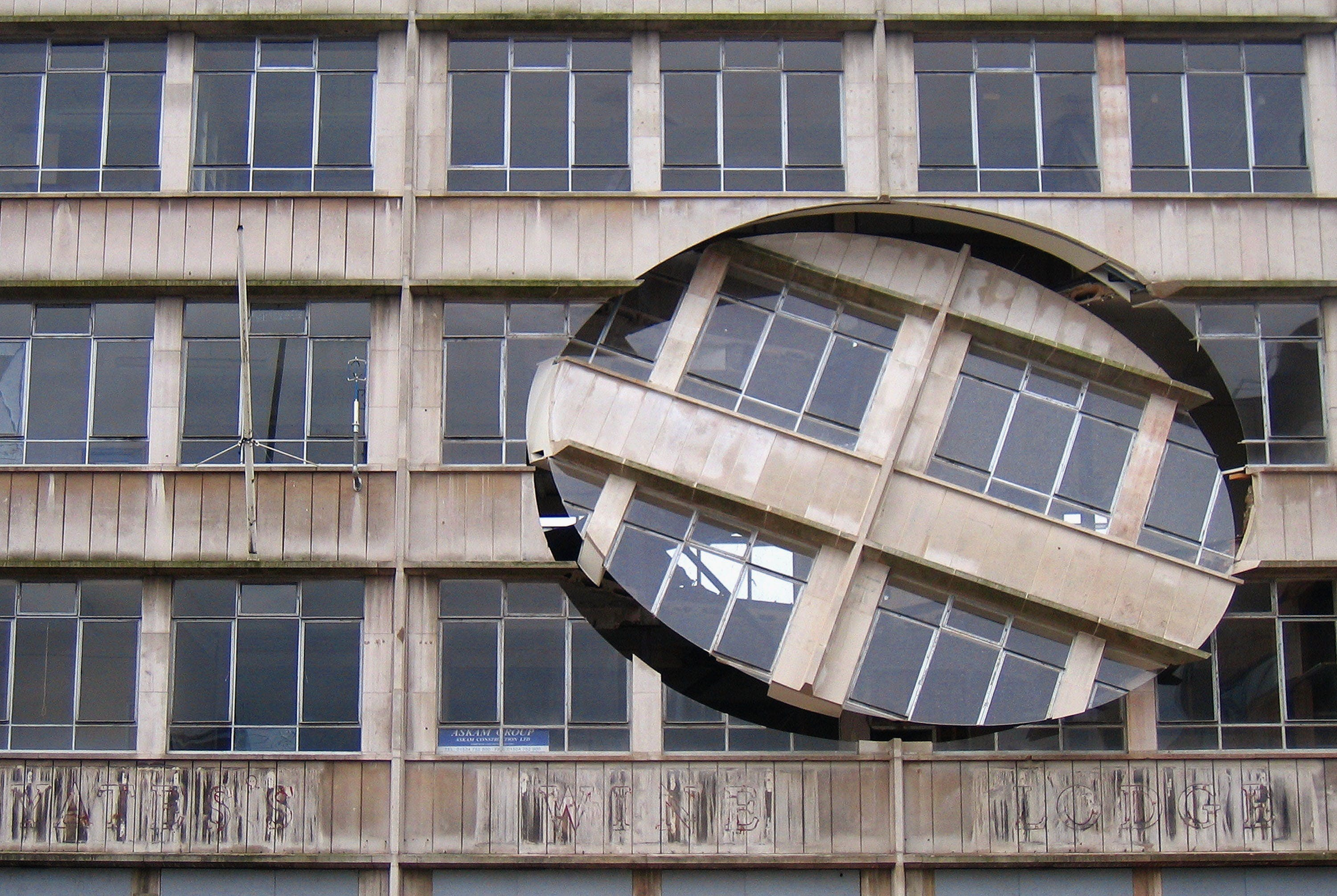 Turning The Place Over (2007), Richard Wilson. The work was built into the condemned Cross Keys House in Moorfields as part of the Capital of Culture for 2008, in June 2007 in Liverpool, England.